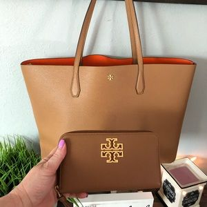 Tory Burch large tote with matching wallet.